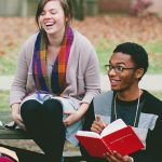 Antioch College students discuss a book together