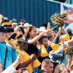 Allegheny College students cheer at a football game