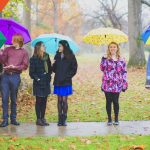Antioch College students hold umbrellas in the rain