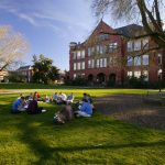 Willamette University students look out onto the sea