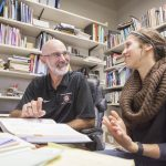 A Willamette University student and professor meet together