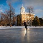 A Lawrence University student ice skates on campus
