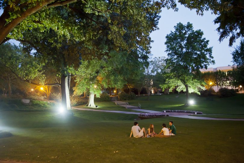 students sitting on the grass at Millsaps College