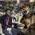 An Ursinus student and the college mascot in our Wismer Dining Facility