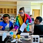Eckerd College students work with a faculty member