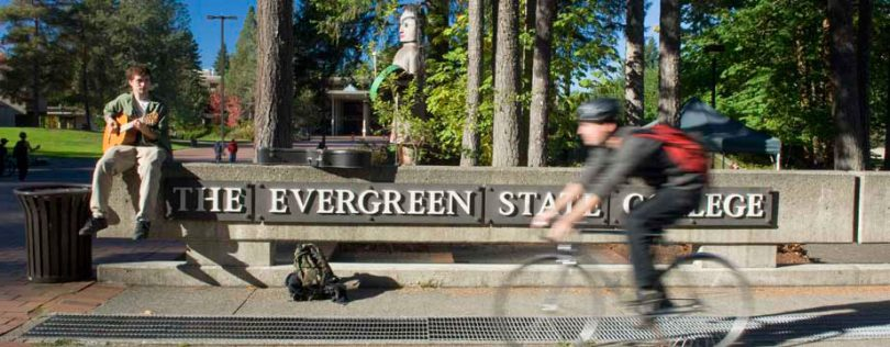 Evergreen State College students walk and ride bikes on the campus.