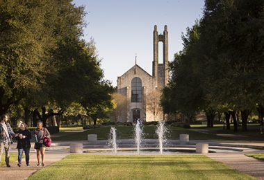 Southwestern University students walk across the campus on a sunny day