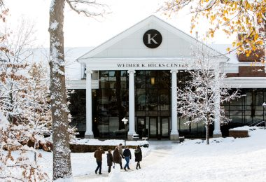 Visitors walk toward Hicks Student Center in winter