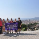 students holding a Millsaps College banner in Florence, Italy