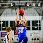 Goucher College basketball player shoots a ball