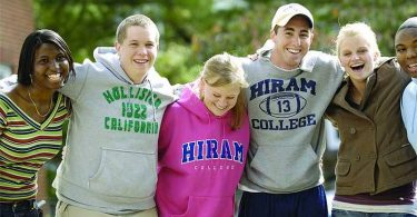 Hiram College students stand arm-in-arm on campus