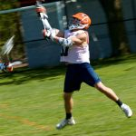 A Hope College student plays lacrosse
