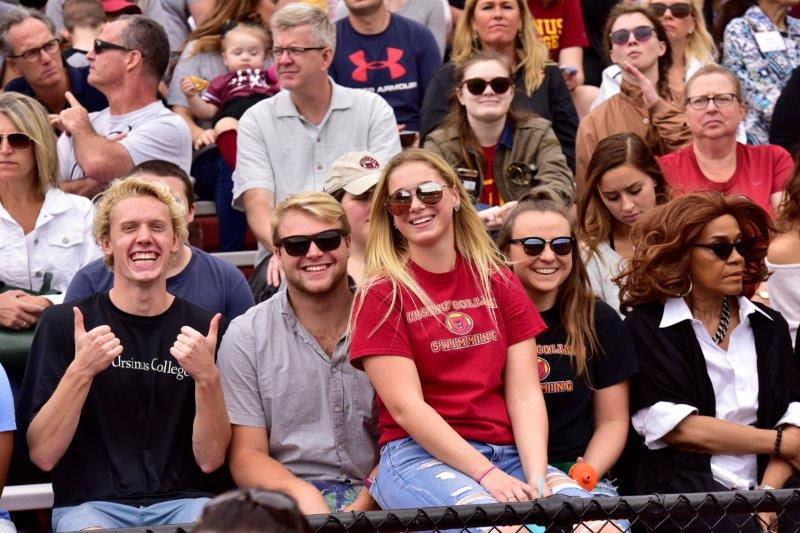 Students cheering on the Ursinus football team at a home game