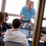 A Juniata College professor speaks with students in class
