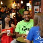 Lynchburg College students visit together over coffee