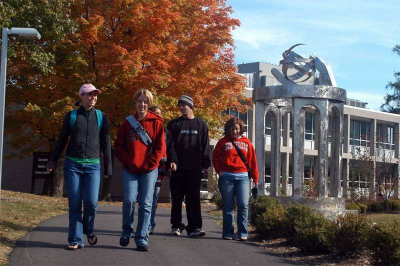Ohio Wesleyan University students walk to class on an autumn day