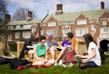 Reed College students sit on the campus lawn together