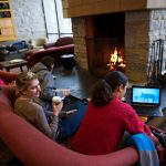 St. Olaf College students study in front of the fireplace