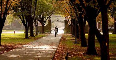 Ursinus College students walk across campus on an autumn day