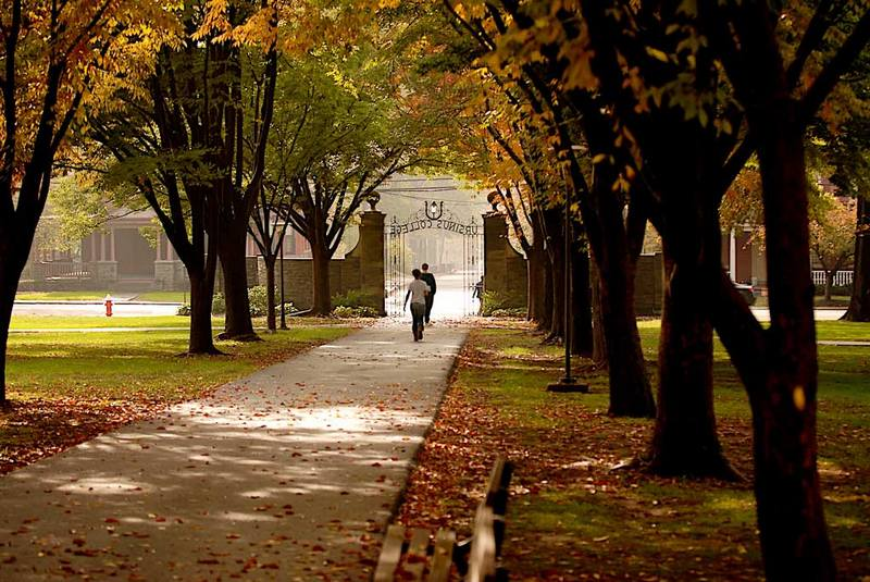 Ursinus College students walk across campus on an autumn day