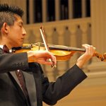 A Wheaton College student plays the violin