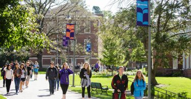 Cornell College students walk to class on a sunny fall day
