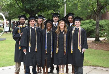 New gradautes pose for photos at Birmingham-Southern College