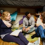Cornell College students hang out in a residence hall room