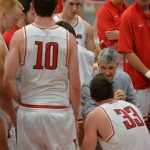 Basketball coach mentors his team