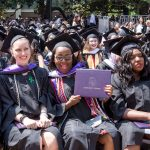 Agnes Scott students showing off diplomas for Commencement 2018.