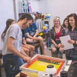 BSC students in a printmaking class with art faculty