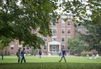 Students walk across the Earlham College campus