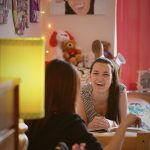 Students laughing in an Agnes Scott dorm room.