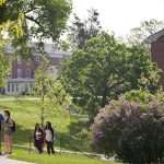Cornell College students walk across campus on a spring day