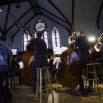 Cornell College students perform in a band together