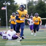 Beloit College varsity football players on the field