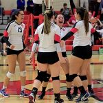 The Clark women's volleyball team celebrate after a point