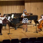 Student musicians perform in the campus Recital Hall.