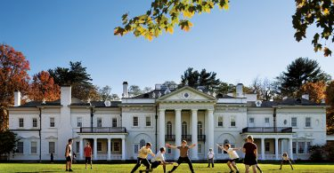 Students play Ultimate on campus in front of Blithewood Manor, which is home to the Levy Economic Institute at Bard.