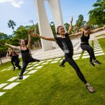 Dance students perform outdoors around the New College Bell Tower