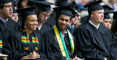 International Wooster students sitting at graduation