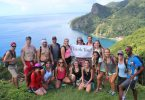 Eckerd students pose together on Dominica during a study abroad term.