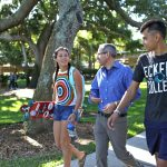 Madeline Vargo '20 and Jonathan Sakai '21 stroll through Hough Quad with Nazarré Merchant, Associate Professor of Mathematics
