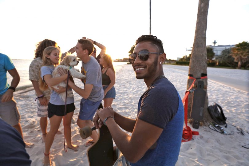 Sakerian Morris '20 and students hanging out on South Beach