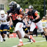 A Kalamazoo College running back runs during a football game