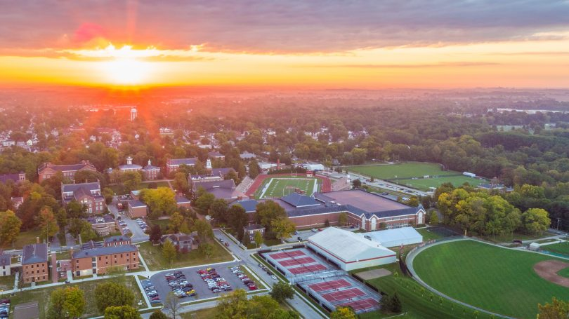 The sun rises over the Wabash College campus