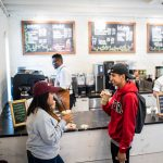 : Two Guilford College students enjoy iced drinks at Rachel's Rose Cottage, the on-campus coffee shop.