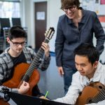A Guilford College Music professor collaborates with two guitar majors at Dana Auditorium.