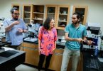 Physics students and professors working together in a lab at New College of Florida
