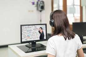 a student listens and watches an online course